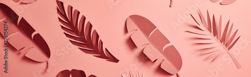 Fototapeta panoramic shot of paper cut palm leaves on pink background, seamless pattern
