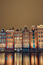 Brick Houses And Canal In Amst...