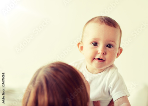 Poster Individuel family, children and people concept - happy little baby with mother at home