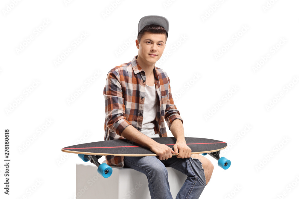 Fototapety, obrazy: Male teenager sitting with a longboard