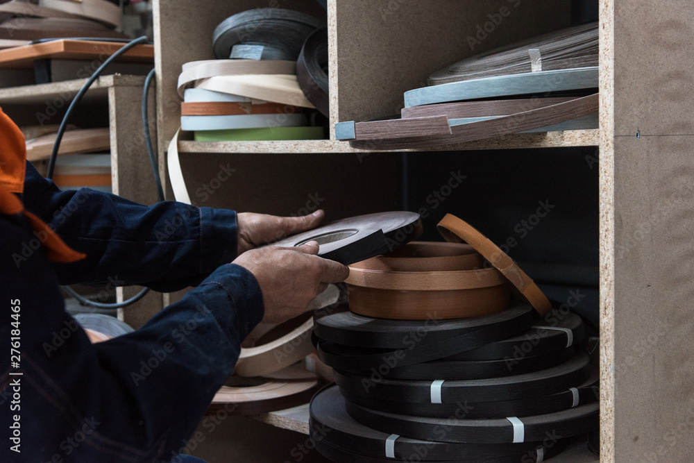 Fototapety, obrazy: Furniture production concept: man working at furniture factory