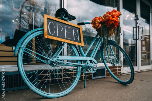 Bicycle with creative open signboard. Open store Canvas Print