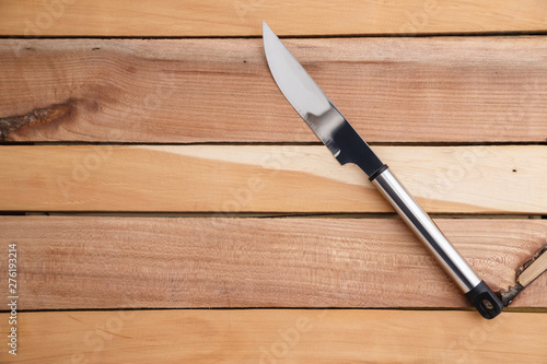 Fototapeta meat carving knife with iron handle on wooden background obraz na płótnie
