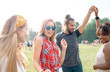 Group of young people having fun at music festival