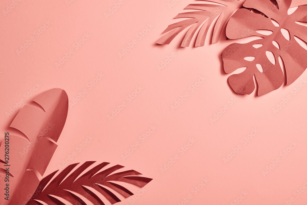 Fototapety, obrazy: top view of paper cut exotic leaves on pink background with copy space