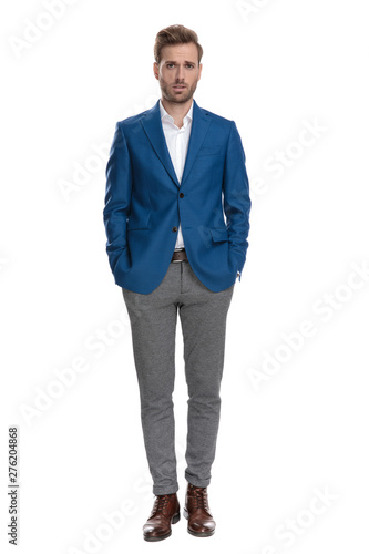 Concerned casual man holding both hand in his pockets Wall mural