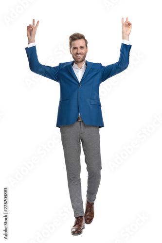 Deurstickers Ontspanning Positive casual man walking and gesturing peace