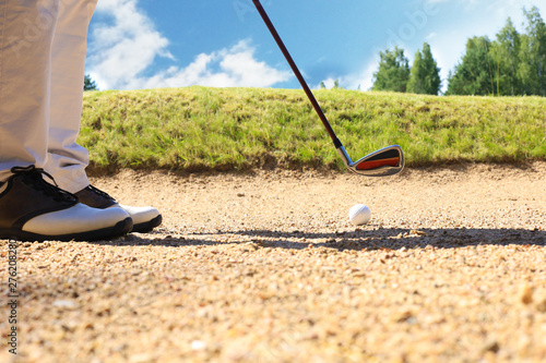 golf shot from sand bunker golfer hitting ball from hazard. Fototapeta