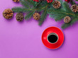 canvas print picture - Hot coffee and pine branch with christmas toys on violet background.