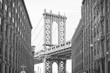 Manhattan Bridge with the Empire State Building through the Arches, New York City, New York