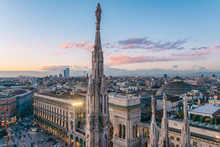 View Of The Statues On The Cathedral Of Milan And The Skyline Of Milan Seen In The Background, Milan, Lombardy