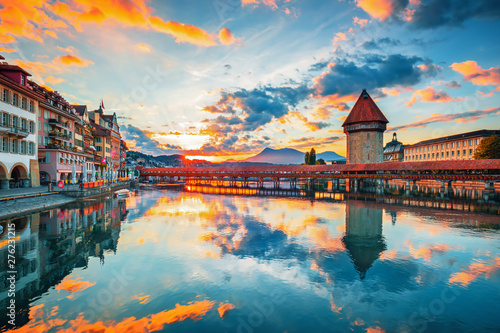 Fototapeta Sunset in historic city center of Lucerne with famous Chapel Bridge and lake Luc