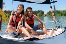 Couple In Love On A Sail Boat In The Summer