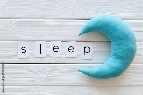 Poster Individuel Sleep word and moon on white wooden background top view