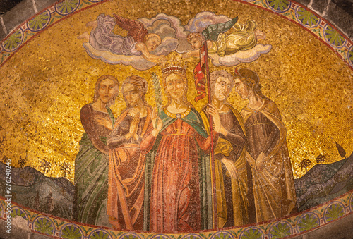 BELAGGIO, ITALY - MAY 10, 2015: The mosaic of St. Ursula and the virgins in church Chiesa di San Giacomo by Venetian school from end of 19. cent.