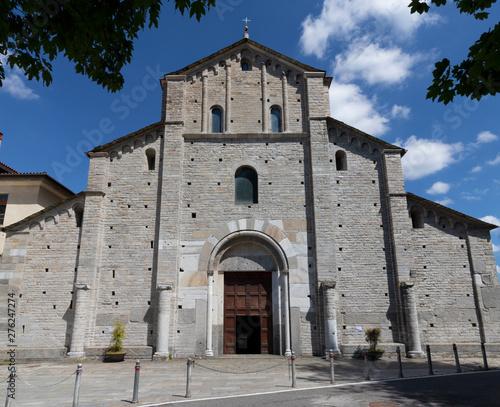 COMO, ITALY - MAY 9, 2015: The facede of romanesque church Basilica di San Abbondio.