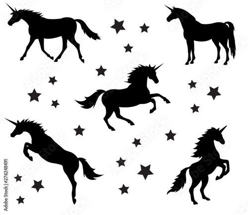 Slika na platnu Vector set of different black flat silhouettes of unicorn isolated on white back