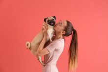 Teenage Girl With Cute Pug Dog...