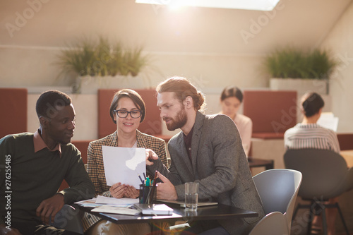 Warm toned portrait of group of people working in cafe, copy space Fototapeta