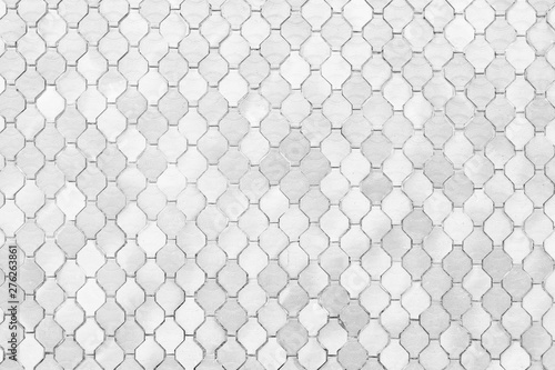 Fotografiet  surface of the white tiles wall.