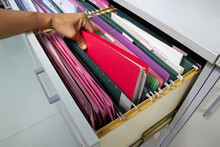 Hand Of Man Search Files Document In A File Cabinet In Work Office