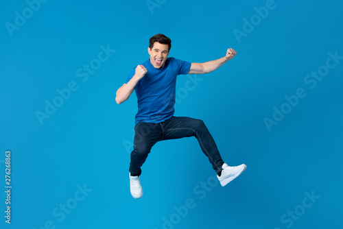 Tela American man jumping and enyoying his success