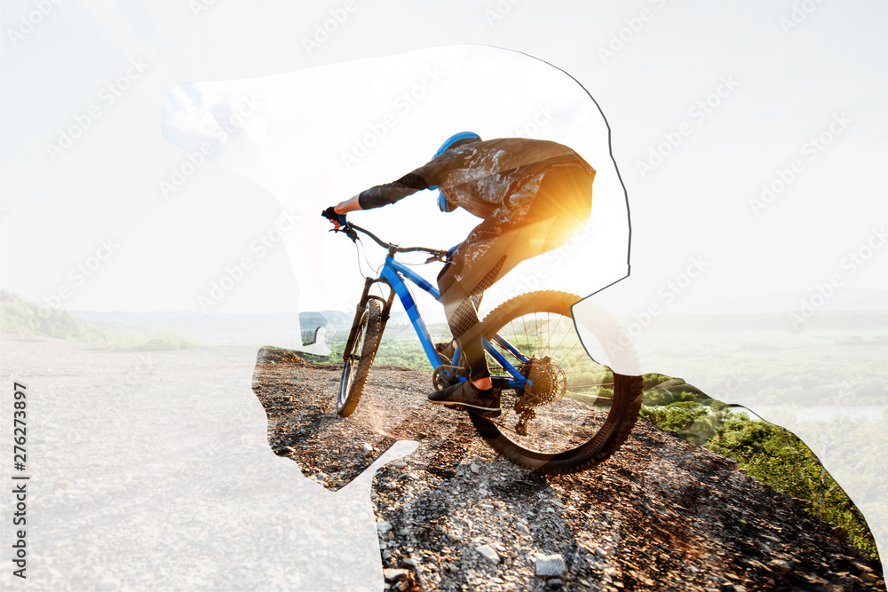 Fototapety, obrazy: Double exposure of a man in protective helmet and professional cyclist riding on the mountains. Concept of a freeride and off road cycling