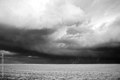 Foto op Plexiglas Grijs Dark cloudy sky before a storm outside the city and on the estuary. Black and white. Nature of Ukraine.2019