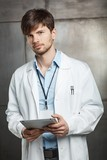 Male doctor holding tablet - 276286214