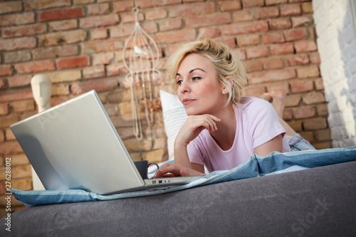 Blonde woman using laptop computer