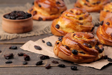 Tasty Buns With Raisins On A Brown Wooden Table. Fresh Bakery. Breakfast. Bread. Close-up