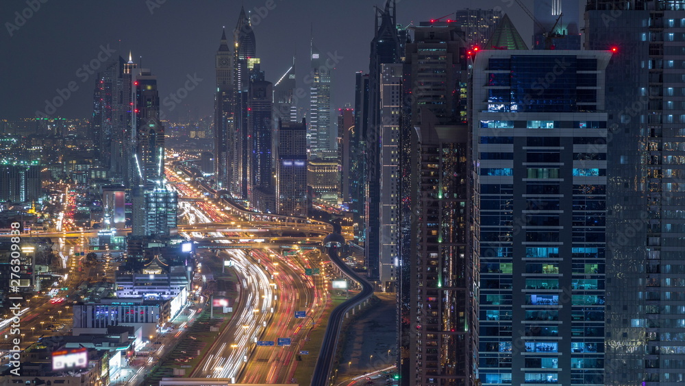 Fototapety, obrazy: Aerial view to skyscrapers on Dubai downtown and Sheikh Zayed road night timelapse, Dubai, United Arab Emirates