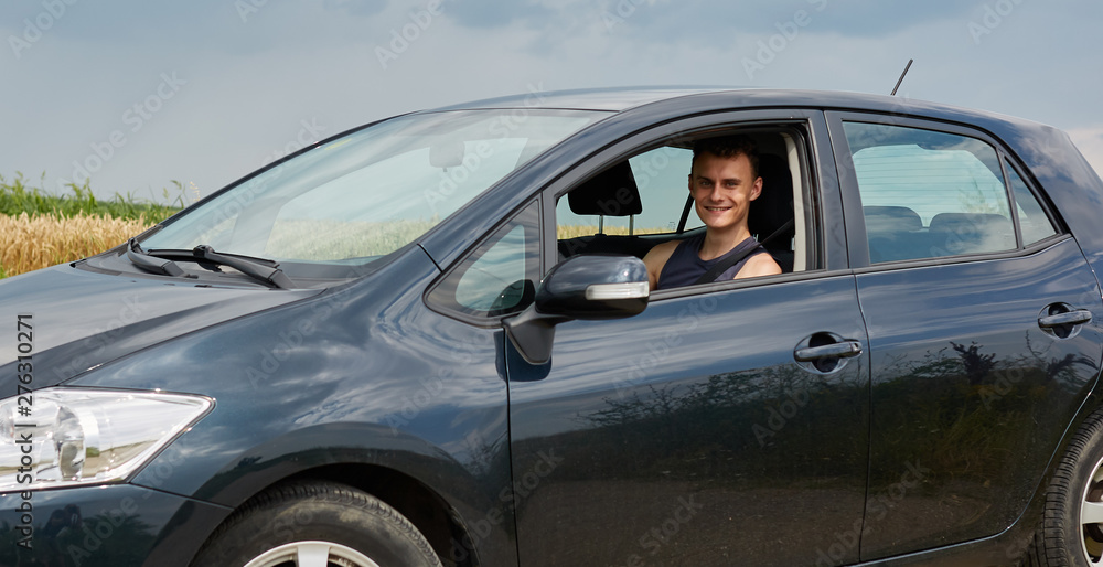 Fototapety, obrazy: Happy young man with new car