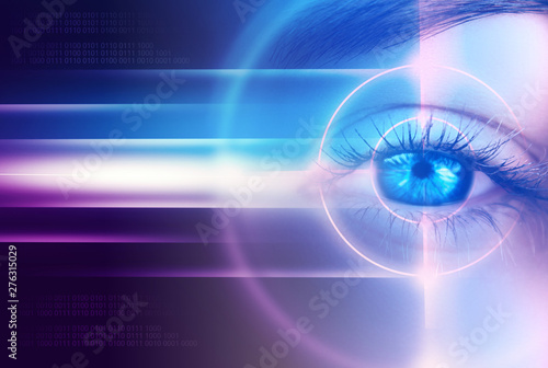 Fotografía  Eye of the female on a dark abstract background, neon holograms, retina scanner