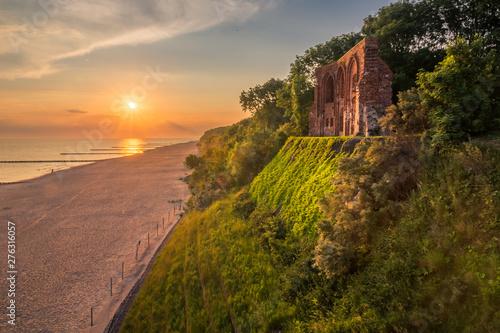 Sunrise over the ruins church in Trzesacz, Poland