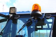 Headlights And Yellow Flasher On Excavator Cab