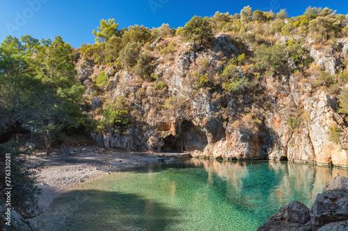 Fotografie, Obraz Beautiful Pirate bay or Korsan koyu, near the village of Karaoz, Mediterranean Sea, Turkey