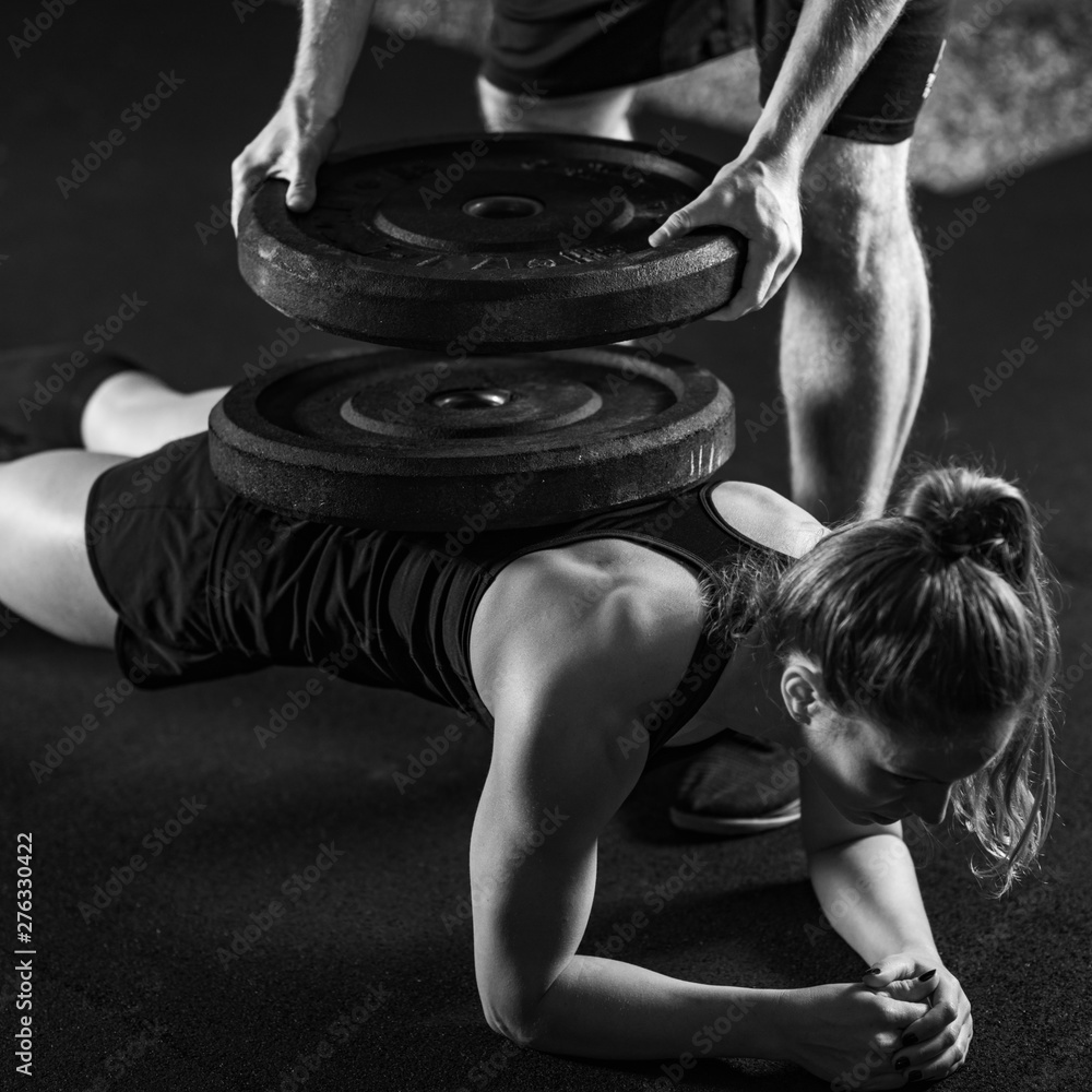 Fototapety, obrazy: Cross training. Young athletes with heavy barbells