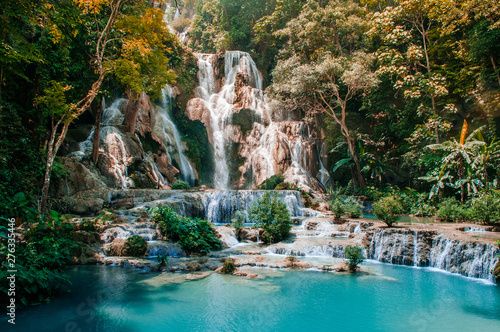 Blue water pond Kuang Si waterfall in Luang Prabang, Laos during summer season.