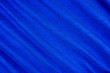 canvas print picture - Bright blue fabric texture with folds.