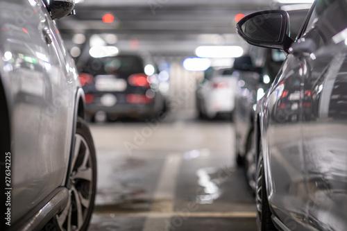 Obraz na plátně Underground garage or modern car parking with lots of vehicles, perspective