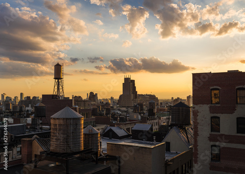 Summer Sunset light on Chelsea rooftops, the Walker Tower, and water towers Wallpaper Mural