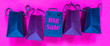 Leinwandbild Motiv Shopping, big discounts, promotions. Paper shopping bags for sales days. Neon pink background, trend