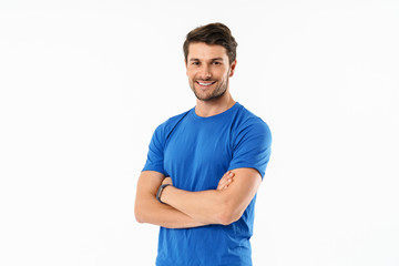 Attractive young fit sportsman wearing t-shirt standing