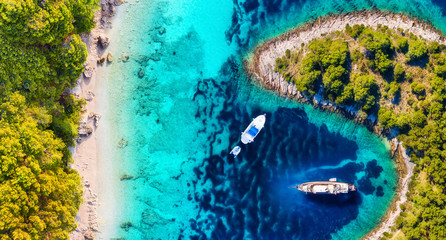 Yachts on the water surface from top view. Turquoise water panoramic background from drone. Summer seascape from air. Croatia. Travel - image