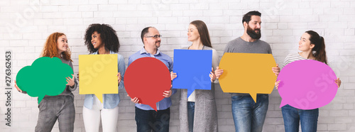 Stampa su Tela  Group of millennials holding blank colorful speech bubbles