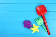 Plastic Beach Toys On Blue Woo...
