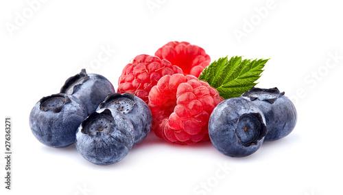Leinwand Poster Fresh ripe berries in closeup on white background