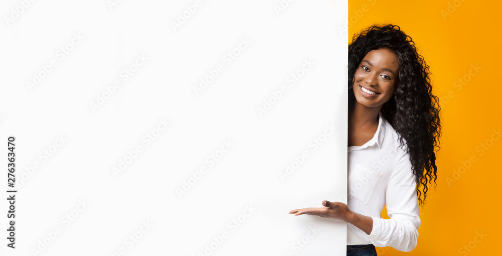 Fototapety, obrazy: African-american man pointing at white blank board