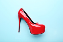 Red High Heel Shoes On Blue Background